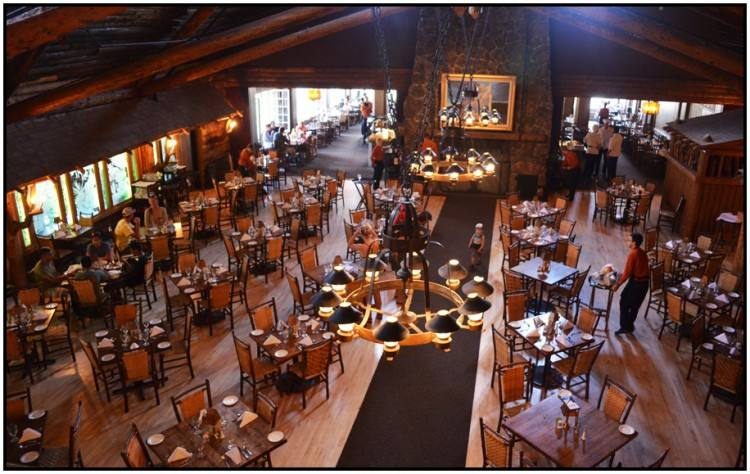 The Old Faithful Inn Dining Room is a spectacular setting to dine while  visiting Yellowstone National Park and offers open views of the incredible  timble