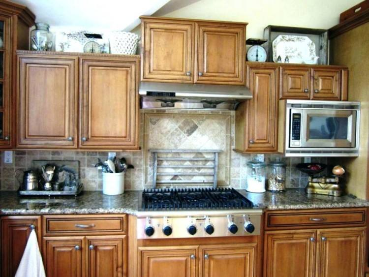 ideas to put on top of kitchen cabinets top kitchen cabinets top of cabinet  decor ideas