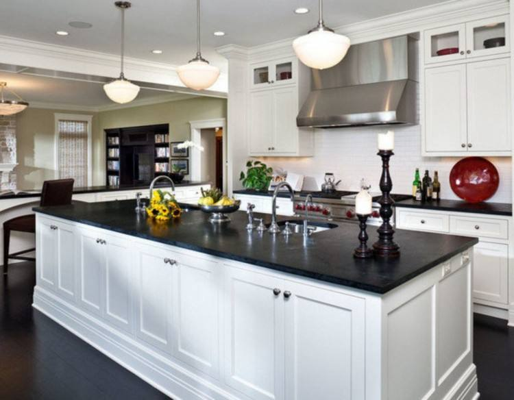 quartz countertops and backsplash with chic kitchen features white shaker  cabinets
