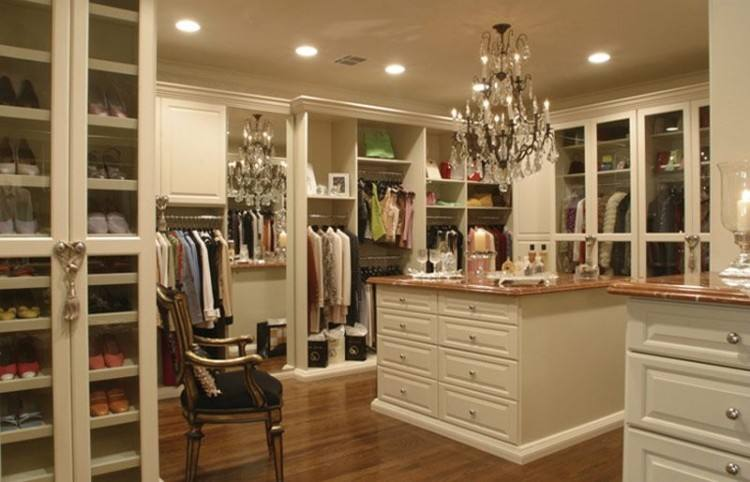 California Closets of Nashville designer Kylee Clement shows Kristie  Barnett with The Decorologist and Elizabeth Scruggs with Superior  Construction the