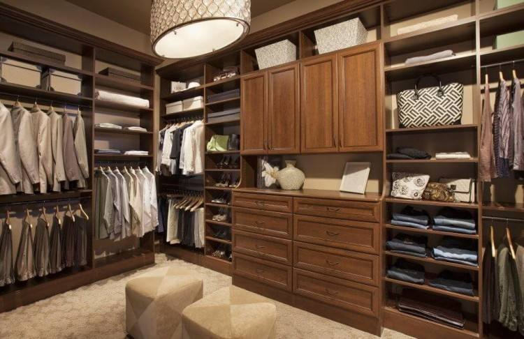 large walk in closet design with an island