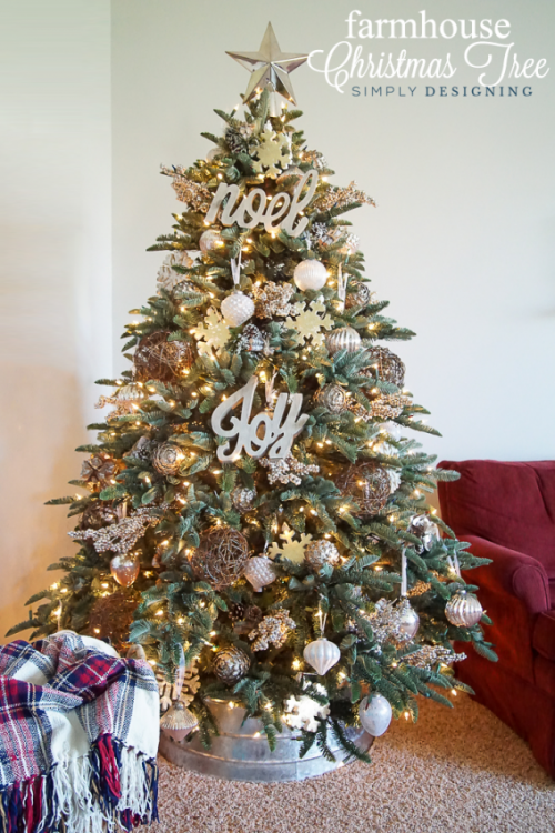 Black, white and gold ornaments on white Christmas tree with stripes  ribbon