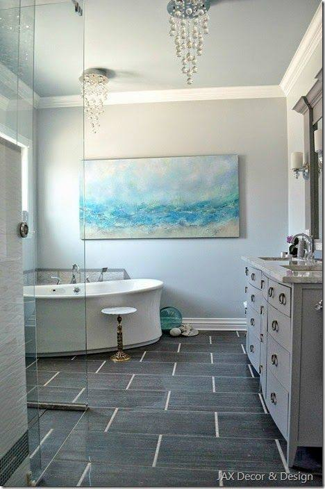 The master bathroom features custom his  and hers vanity painted