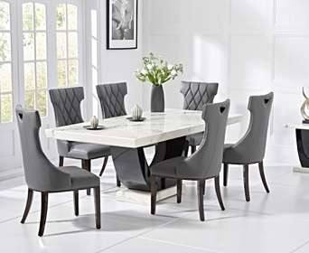 Dining room with dark wood dining table and  grey upholstered dining chairs