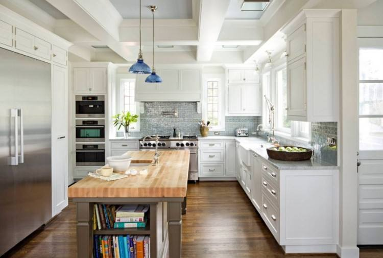Butcher block countertops paired with dark blue painted cabinets