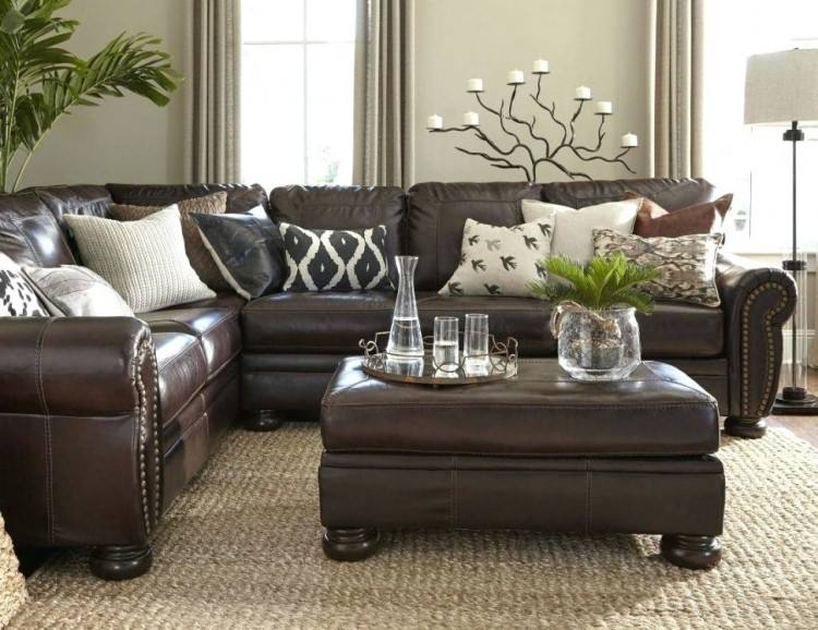 brown couch with turquoise accents decor