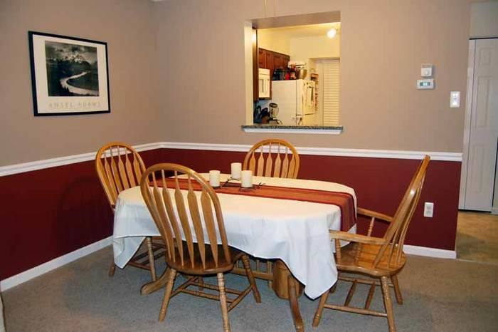 Pale Green Painted Dining Room With Dark Brown Dining Table And Classic  Wooden Vertical Slat Dining Chair Featuring Animal Fur Rug And Elegant  Ceiling