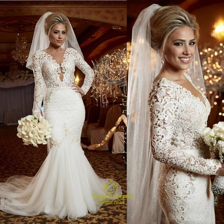 A classic corded lace wedding dress that flows off the hips into a medium  length train