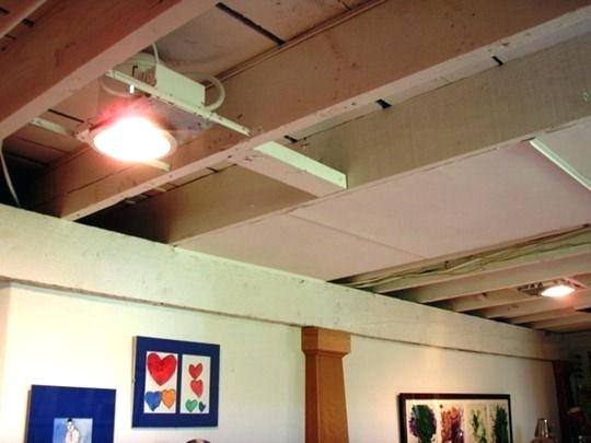 Wrap the light on painted  exposed pipes at different heights