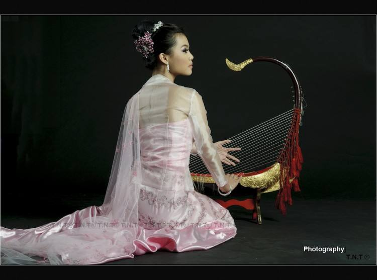 A model performs with Myanmar's traditional dress during the Wedding Dress  Show in Yangon, Myanmar, on July 17, 2011