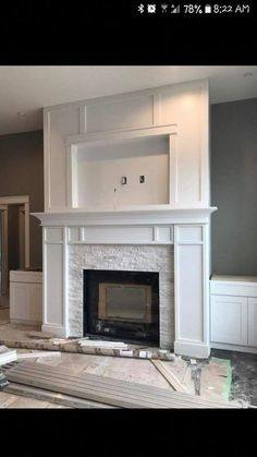 A Large stone accent wall with a built in electric fireplace gives this  lower level a finished look similar to the upper levels of this home