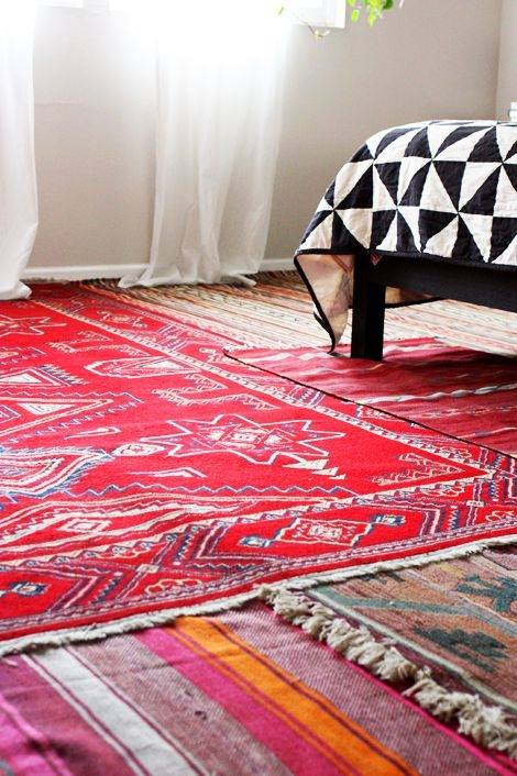 A smaller rug on top of a larger one helps define  seating areas and creates visual interest