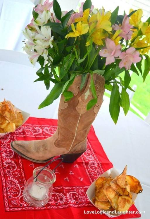 Cowboy boots and sunflowers centerpiece at a Cowgirl Birthday Party! See  more party ideas at CatchMyParty