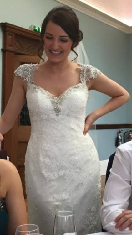 Amy walked down the aisle and danced the night away in a fit and flare Maggie  Sottero wedding dress