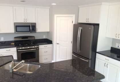 com kitchens with black appliances and cherry cabinets