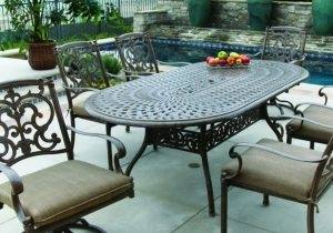 1930s: Back patio of house with wrought iron furniture patio set