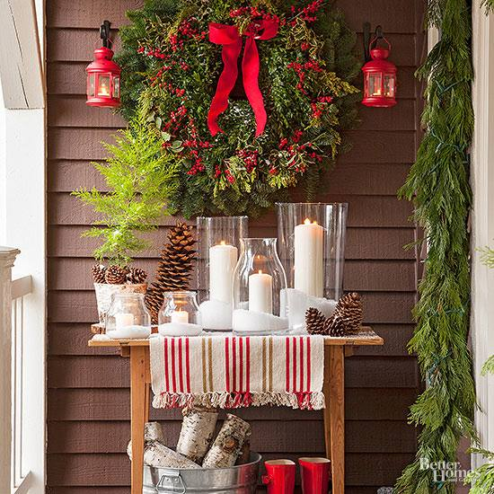 I love this holiday porch! She filled a lantern with  Christmas