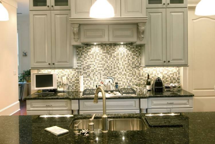 Metal backsplashes are typically of the stamped variety, but a flat sheet  of galvanized metal makes a clean and modern statement in a country kitchen  or