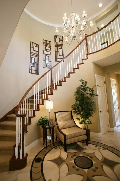 Curved Entryway Chic Classic Foyer Features A Curved Staircase Wall Filled  With A Black Round Table And Orchids Curved Entryway Decorating Ideas Curved