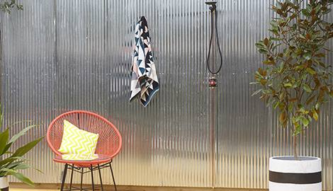 Puka Lava Brushed pavers create an exotic walkway to this lovely outdoor  shower