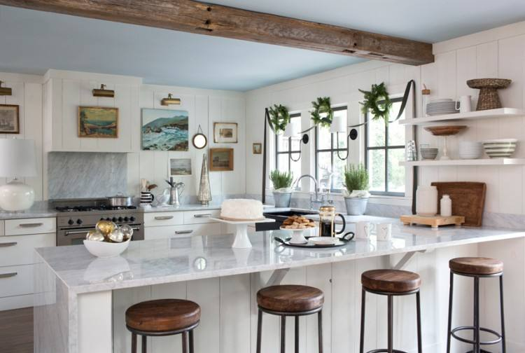 Large kitchen featuring white ceiling and cabinetry