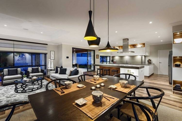 The kitchen and dining room of this home are located on the same level,  with a small living room raised slightly to separate it from the rest of  the space