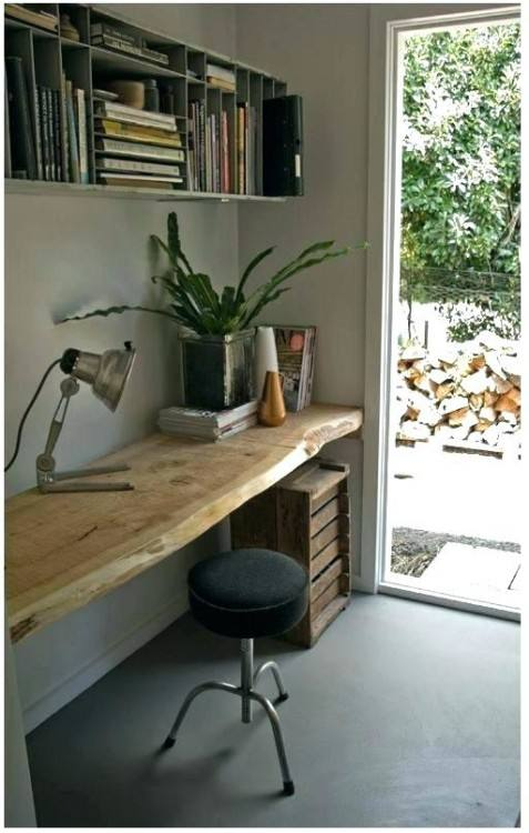 office shelving ideas floating shelves in a niche and a floating desk top  with the same