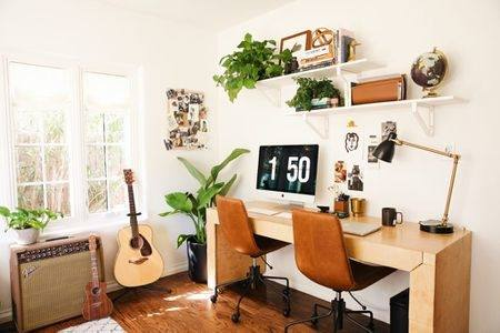 Wishbone chair and sleek desk give the home office an airy ambiance  [Design: Arends